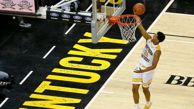 Northern Kentucky Norse guard Dantez Walton (32) breaks away for a layup in the first half of the NCAA Horizon League basketball game between the Northern Kentucky Norse and the Green Bay Phoenix at BB&T Arena in Highland Heights, Ky., on Saturday, Feb. 10, 2018. The Norse took an 86-80 win over Green Bay.