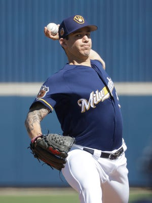 Tommy Milone throws during a spring training game against the Cincinnati Reds.