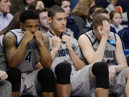 Georgetown Hoyas players react on the bench when they were upset by Florida Gulf Coast during the 2013 NCAA tournament.
