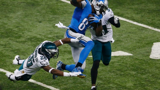 Detroit Lions wide receiver Calvin Johnson (81), defended by Philadelphia Eagles strong safety Walter Thurmond (26) and cornerback Byron Maxwell (31) makes a catch during the first half of an NFL football game, Thursday, Nov. 26, 2015, in Detroit. (AP Photo/Paul Sancya)