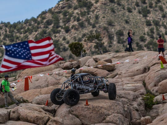 A driver navigates a course during the rock crawling