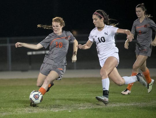Lely's Saoirse Bowe tries to keep the ball from Mariner's