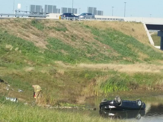Five adults and a child were hospitalized Wednesday afternoon after the car they were riding in plunged down an embankment and into a retention pond near Christiana Mall. This photo was submitted by Victor Kakulu, who was one of the bystanders who helped.