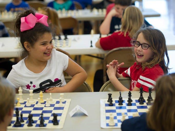 Tracie Mae Skelton, 9, Joshua Academy, left, and Lydia