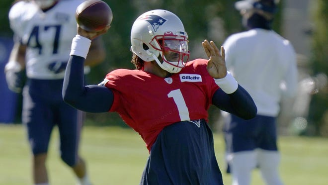 New England Patriots quarterback Cam Newton passes during an NFL football training camp practice, Thursday, Aug. 20, 2020, in Foxborough, Mass.