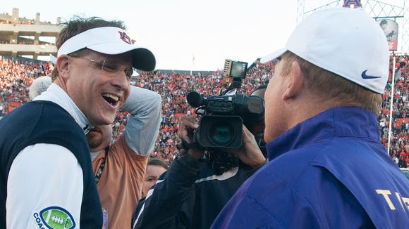 Auburn \coach Gus Malzahn greets LSU coach Les Miles before Saturday's game.