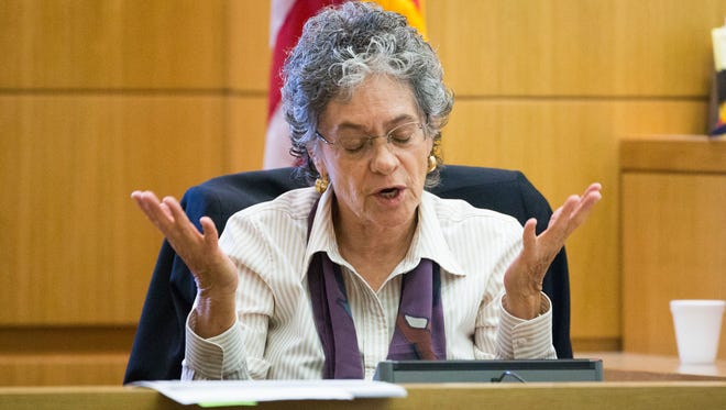 Dr. L.C. Miccio-Fonseca answers a question while being cross-examined by Prosecutor Juan Martinez in the sentencing retrial of Jodi Arias in Maricopa County Superior Court in Phoenix, Tuesday November 25, 2014.