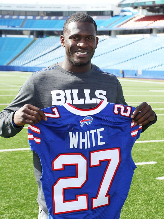 Buffalo Bills' first-round NFL football draft pick Tre'Davious White poses for photos following a media conference at New Era Field in Orchard Park, N.Y., Friday, April 28, 2017. (AP Photo/Bill Wippert)