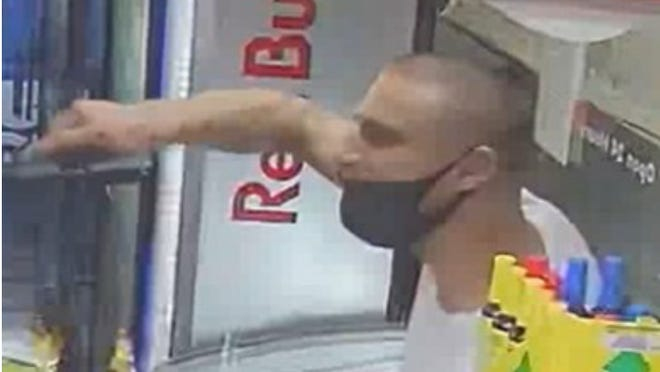 Austin police on Tuesday asked the public's help in identifying a man, pictured above, who authorities have accused of holding a gun to the head of a person at a gas station in Northwest Austin.
