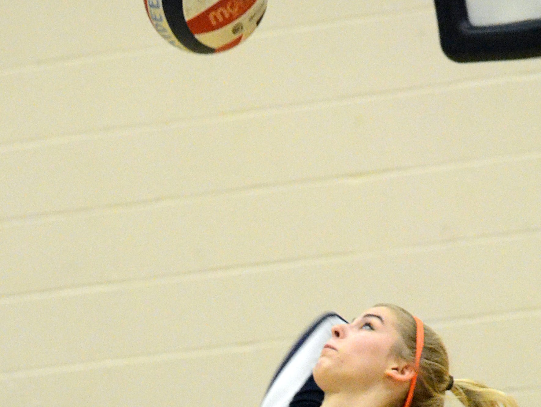 Beech High junior Calista Foster swings into a jump-serve during the first game.
