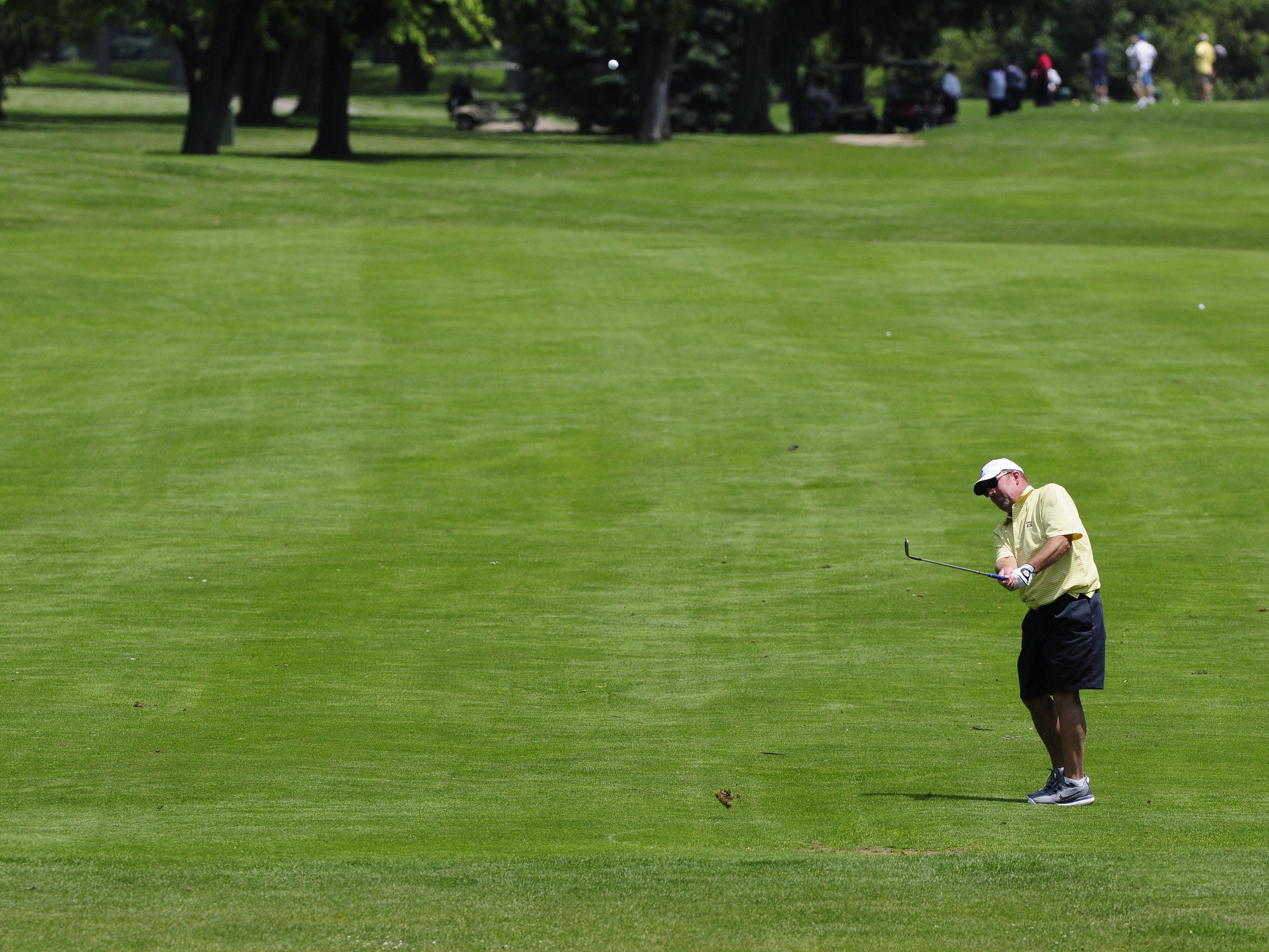 Markus Schulz hits the ball down the 18th fairway Friday, July 10 during the Port Huron Elks 2015 Men's Invitational in Port Huron Township.