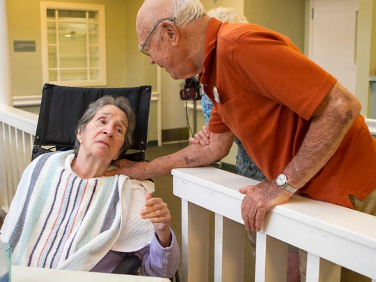 Stuart Hodes visits his wife, Helen, who has Alzheimer's. They live in the same facility, but Stu has a private apartment and Helen is in the secure nursing area. He spends more than $20,000 a month for her care and his apartment.