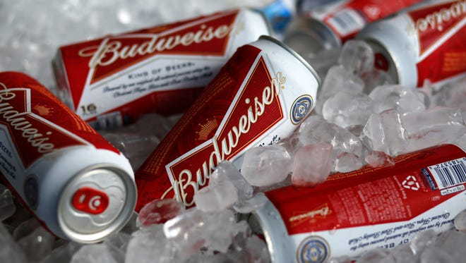 In this Thursday, March 5, 2015, file photo, Budweiser beer cans are seen at a concession stand at McKechnie Field in Bradenton, Fla.