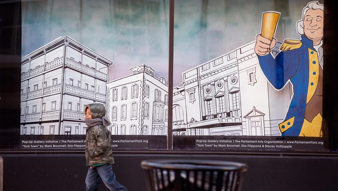 Parliament Arts Organization has installed art displays in the windows on the ground floor of the Yorktowne Hotel in York.