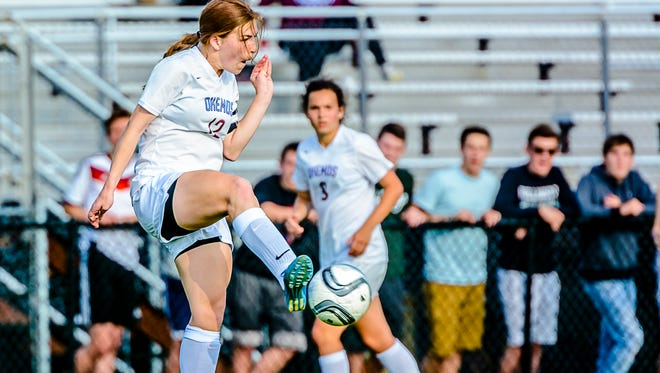 Anne Major of Okemos clears the ball from in front of the Okemos goal in the 2nd half of the Chiefs' CAAC Gold Cup semifinal game with Williamston.