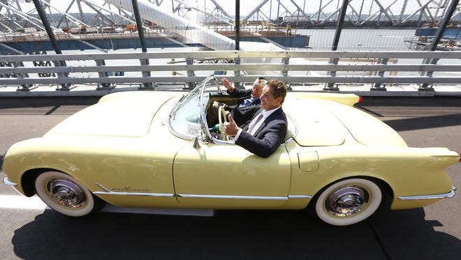 "Armando ""Chick"" Galella, of Sleepy Hollow, N.Y., a World War II veteran who survived the attack on Pearl Harbor, rides with New York Gov. Andrew Cuomo across the new Tappan Zee Bridge on Thursday, Aug. 24, 2017, during the opening ceremony."