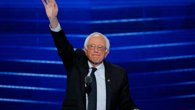 Sen. Bernie Sanders, I-Vt., waves to the delegates before addressing the first day of the Democratic National Convention in Philadelphia on July 25, 2016.