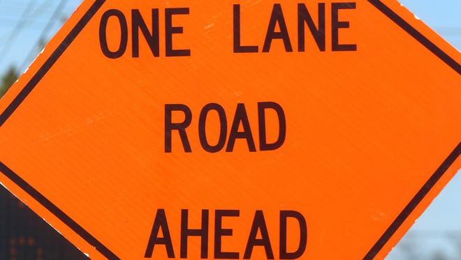 One Lane Road Ahead sign.
