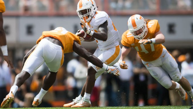 Tennessee running back Trey Coleman (24) *** Tennessee defensive back Todd Kelly Jr. (24) before the Tennessee Orange & White spring game at Neyland Stadium at University of Tennessee Saturday, April 21, 2018.