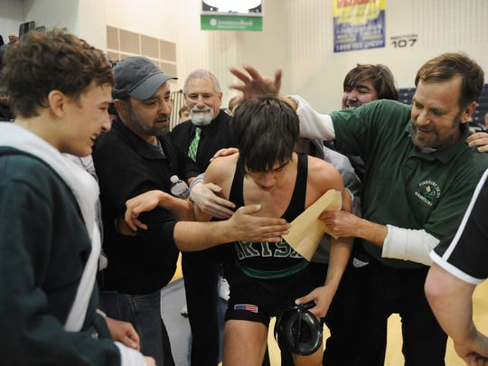 Camden Catholic coaches and fans celebrate with Anthony Croce after pinning Paulsboro's Joey Perez in the 132-lb bout of the Region 7 tournament finals at Toms River High School North on Saturday. 02.25.17.