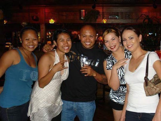 Bert Piolo, center, is shown out with friends. Piolo,