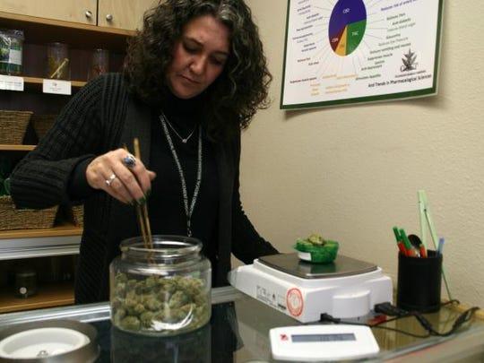 Erica Freeman of Choice Organics weighs cannabis flowers.