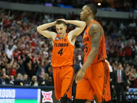 Florida Gators guard Egor Koulechov (4) and forward Keith Stone (25) react to the loss against the Texas Tech Red Raiders in the second round of the 2018 NCAA Tournament at American Airlines Center. Mandatory Credit: Tim Heitman-USA TODAY Sports