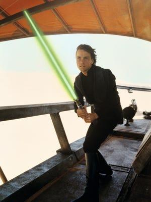 """Luke Skywalker (Mark Hamill) wields his lightsaber in """"Star Wars: Return of the Jedi."""""""