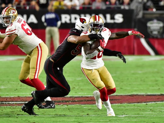 Jordan Hicks tackles 49ers running back Tevin Coleman during a game Oct. 31 at State Farm Stadium.