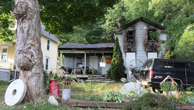 A man was found dead after a fire at a home on Prospect Street in Palmyra Wednesday.  Significant fire damage was seen on the home, Thursday, Sept. 8, 2016.