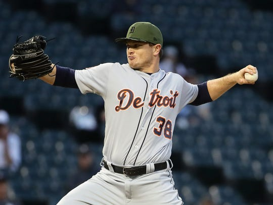 Justin Wilson pitches in the 9th inning of a Tigers