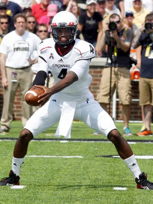 Ten months after surgery to repair his torn ACL and PCL, Munchie Legaux hopes to contend to regain his job as Cincinnati's starting QB.