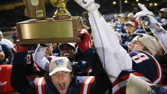 American Leadership Academy players celebrate after beating Tucson Sabino in the 3A football state championship in Scottsdale November 26, 2016.