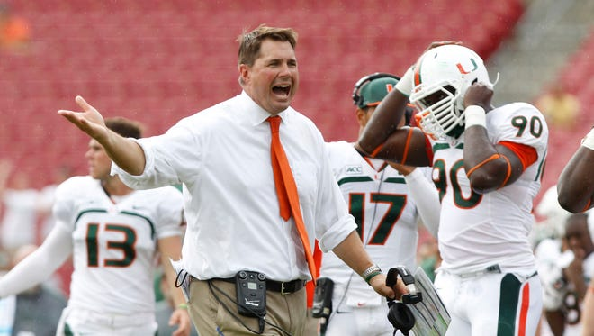 Miami Hurricanes coach Al Golden reacts during the second half of his team's game against South Florida.