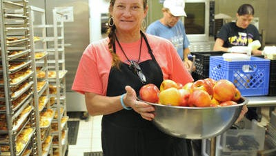 Kitchen volunteers prepare lunch at Daily Bread in Melbourne. Daily Bread has been working with the homeless and the working poor since 1987.   Kitchen volunteers prepare lunch. Daily Bread in Melbourne is nominated for a VRA 2015 award. They have been working with the homeless and the working poor since 1987.
