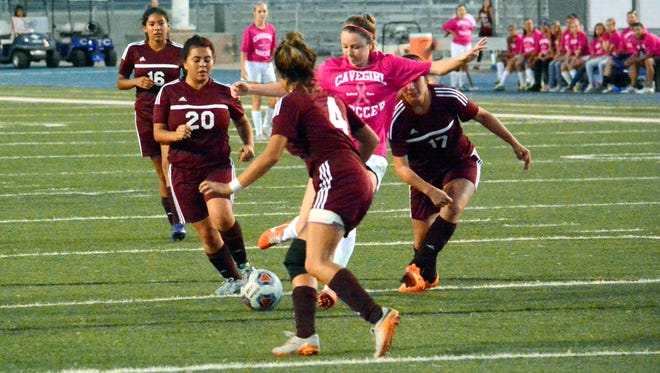 Carlsbad's Hayven Burkeen fires a shot with a trio of Gadsden defenders surrounding her in the first half Tuesday.