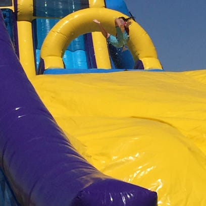 The water slide sent kids flying in the air, then safely