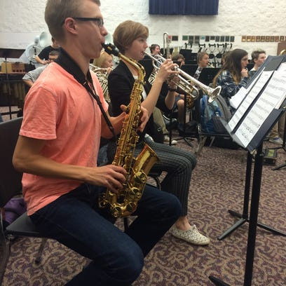 Jeremy Turvo and Emily Rex practice their instruments