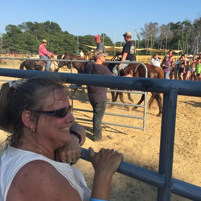 Jennifer Cersley watches the corral of the southern