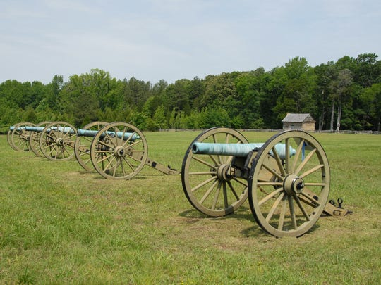 Union artillery pieces stand as silent sentinels near the William Manse George cabin at the Shiloh National Military Park.