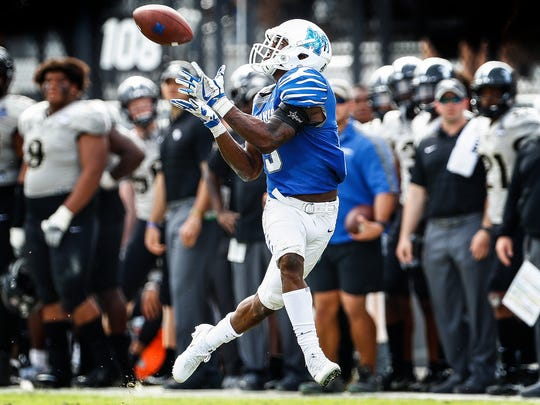 Memphis receiver Anthony Miller hauls in a 68 yard touchdown catch in front of the UCF bench during second quarter action of the the AAC Championship football game in Orlando, Fl., Saturday, December 2, 2017.