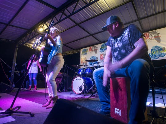 Clint Smith, right, plays the drum box as he accompanies Chloe Channell during a past show. Channell will headline Thursday's Tunes by the Dunes at the Sand Crab Pavilion on Navarre Beach Park.