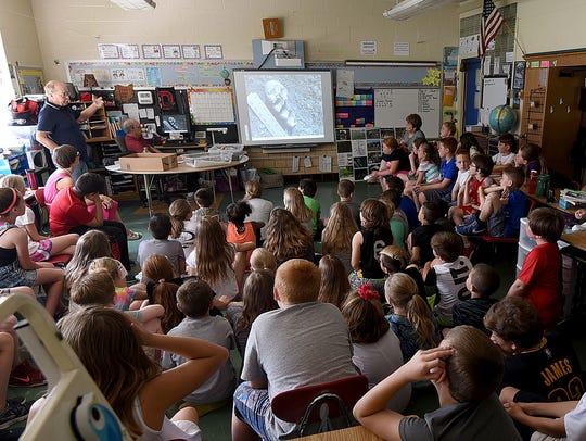 Clint Walker talks to fourth grade students at Lexington