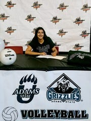 Centennial volleyball player Jayden Nanez signed this