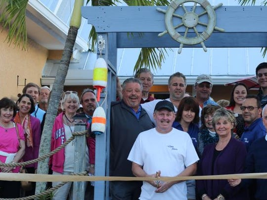 Sanibel Captiva Chamber of Commerce, along with several business members, welcomed The Clam Shack with a ribbon cutting at the restaurant. Owners Mark and Laurie Thomas, center, cut the ribbon.