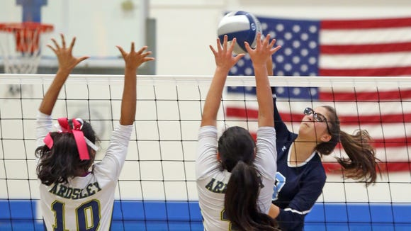 Ardsley's Kruti Sutaria (10) and Christina Chu (4)  block Westlake's Sydney Roell (8) shot during Section 1 Class B girls volleyball semifinal against Ardsley at Westlake High School in Thornwood Nov. 3, 2016.