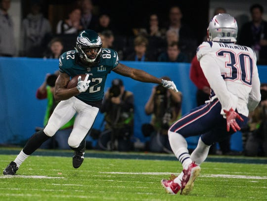 Eagles' Torrey Smith looks for a way around the Patriots' Duron Harmon during Super Bowl LII.