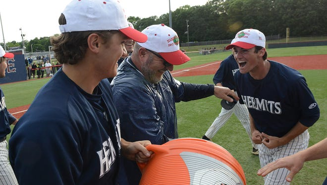 St. Augustine coach Mike Bylone reacts after his players dump the water cooler on him after defeating Gloucester Catholic 8-5 in the Diamond Classic tournament final at Eastern High School on Sunday. 05.21.17