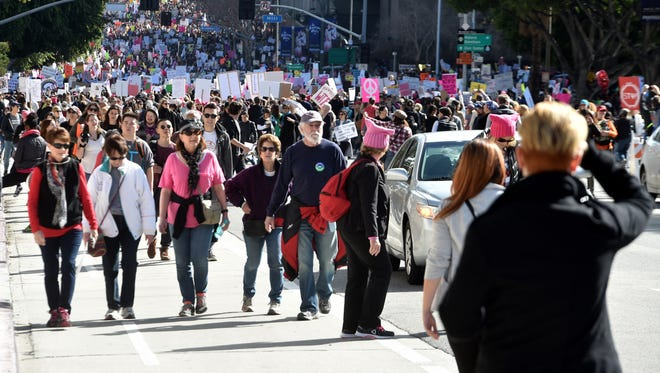 Thousands of people march in the streets of downtown Los Angeles in a women's march the day after President Donald Trump's inauguration.