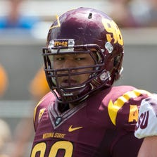 ASU DL #98 Mo Latu after a play during a gold vs. maroon game at Sun Devil Stadium during Fanfest on April 19,2014.